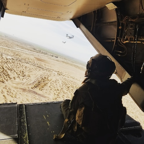 """U.S. Marine Corps Cpl. Karissa Tanguay-Jones, a native of Colorado Springs, Colorado, sits in the back of an MV-22 Osprey during a recent training flight in California. Tanguay-Jones stars in """"A Nation's Call,"""" the latest advertisement released under the Marine Corps' """"Battles Won"""" strategy. The commercial unfolds by showcasing the full power of the United States Marine Corps engaged in an assault mission. Depicting a 5th Generation Marine Corps operation (naval integration, ship-to-objective, technology-fueled). As the Marines move toward the objective, each layer of ships, tanks, armored vehicles, planes and helicopters is removed. This visual story, in combination with the voiceover, will communicate and emphasize to the audience that, when the Nation faces any battle, the Marines themselves—with their fighting spirit—are the greatest weapon in the United States Marine Corps' arsenal."""