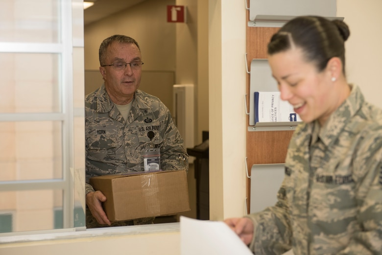 U.S. Air Force Tech. Sgt. Kenneth Horn, 20th Medical Support Squadron (MDSS) outpatient record noncommissioned officer in charge (NCOIC), left, thanks Staff Sgt. Melanie Bedwell, 20th MDSS storage and distribution NCOIC, after receiving his shop's supplies at Shaw Air Force Base, S.C., Jan. 31, 2018.