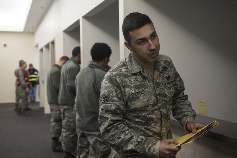 U.S. Airmen process through a pre-deployment line during a Phase I exercise at Shaw Air Force Base, S.C., Feb. 4, 2018.