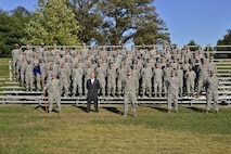 Airmen of the 707th Communications Squadron pose for a group photo October 30, 2017 at Fort. George Meade, Maryland. The 707th CS, aligned under the 70th Intelligence, Surveillance and Reconnaissance Wing, supports more than 5,700 global personnel and 57 National Security Agency missions with their 230 'Thunder Warriors.' (U.S. Air Force photo/Staff Sgt. Alexandre Montes)
