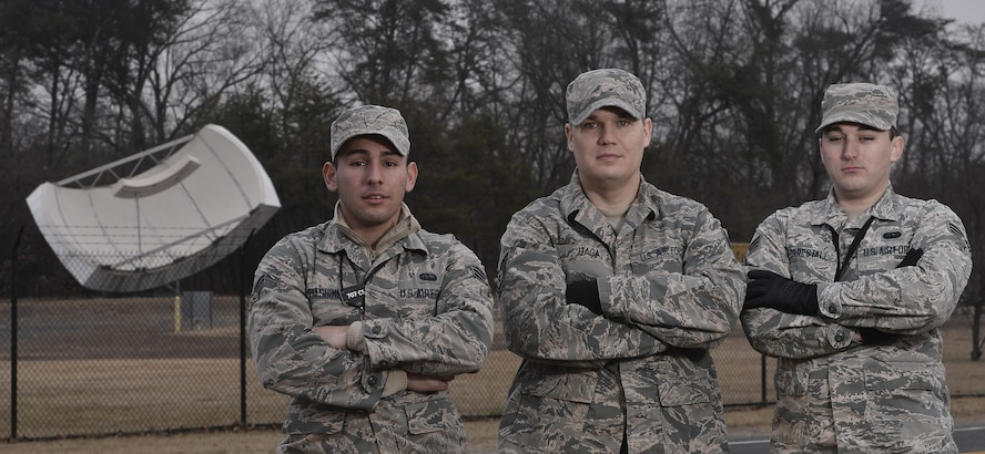 Airmen of the 707th Communications Squadron Special Missions Flight pose for a group photo in front of a satellite Jan. 16, 2018, at Fort George G. Meade, Maryland. These Airmen maintain equipment and ensure satellite signals and transmissions are operational to support the 70th Intelligence, Surveillance and Reconnaissance Wing and it partners. (U.S. Air Force photo/Staff Sgt. Alexandre Montes)