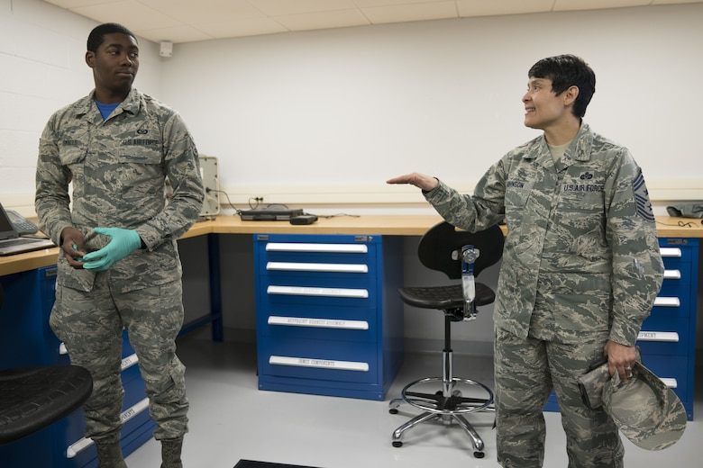 Chief Master Sgt. Imelda Johnson, 22nd Air Force command chief, discusses career progression with Senior Airman Khalil Smalls, 339th Flight Test Squadron aircrew flight equipment helper, Feb. 2, 2018, at Robins Air Force Base, Georgia. Smalls is the lowest ranking individual in his unit and will soon begin Airman Leadership School, the first level of the Enlisted Professional Military Education. (U.S. Air Force photo by Jamal D. Sutter)