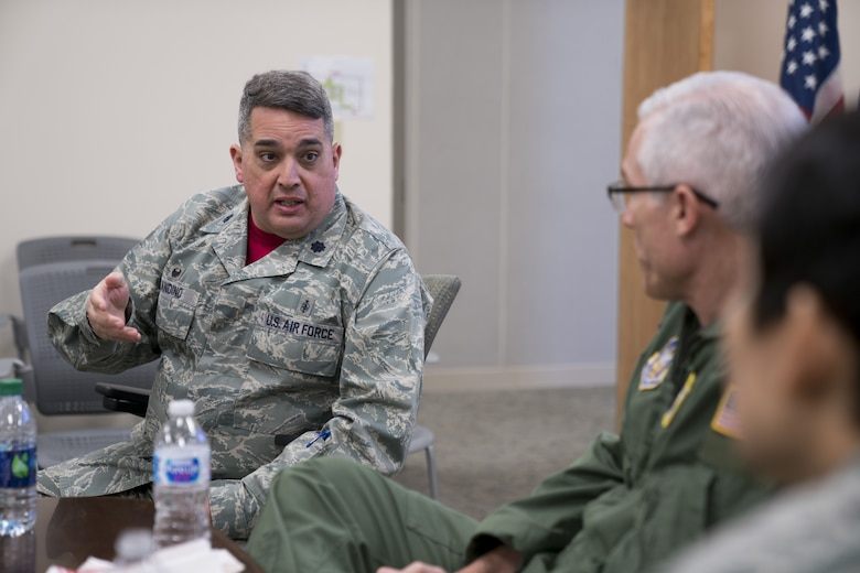 Lt. Col. Rafael Andino, 413th Aeromedical Staging Squadron commander, speaks to Maj. Gen. Craig La Fave, 22nd Air Force commander, and Chief Master Sgt. Imelda Johnson, 22nd AF command chief, Feb. 2, 2018, at Robins Air Force Base, Georgia. La Fave and Johnson had lunch with members of the unit and gave them opportunities to ask questions and discuss concerns. (U.S. Air Force photo by Jamal D. Sutter)