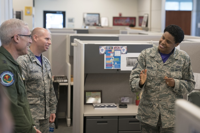 Master Sgt. Aridth Gibbons, 413th Force Support Flight readiness NCO, speaks with Maj. Gen. Craig La Fave, 22nd Air Force commander, Feb. 2, 2018, at Robins Air Force Base, Georgia. This was La Fave's first visit to the unit since taking his new position in November of 2017. (U.S. Air Force photo by Jamal D. Sutter)