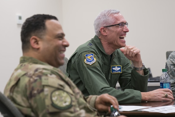 Maj. Gen. Craig La Fave, 22nd Air Force commander, shares a laugh with members of the 413th Flight Test Group during a unit visit Feb. 2, 2018, at Robins Air Force Base, Georgia. During his stay, La Fave got a first-hand look at the 413th FTG mission and discussed topics on various, current Air Force Reserve affairs. (U.S. Air Force photo by Jamal D. Sutter)