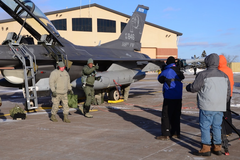 Ron Mott, a nationally-syndicated television broadcaster, gives a thumbs up to his camera crew following his mission familiarization flight with the Minnesota Air National Guard's 148th Fighter Wing, Duluth, MN. The flight showcased NORAD's air-defense mission and included intercept operations with a Civil Air Patrol aircraft and an inflight refueling with a Wisconsin Air National Guard KC-135 from the 128th Air Refueling Wing. NORAD, along with their interagency partners -- the FAA, Department of Homeland Security, and Customs and Border Patrol -- provided the air defense shield for this year's Super Bowl being held in Minneapolis, MN.  (Air Force photo by Maj. Andrew Scott)