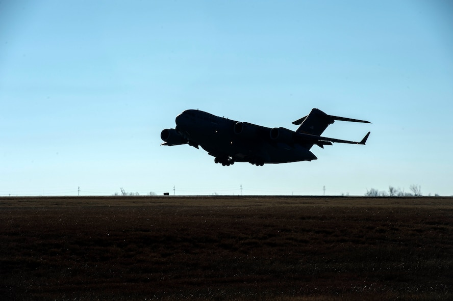 A C-17 Globemaster III takes off to perform aerial training