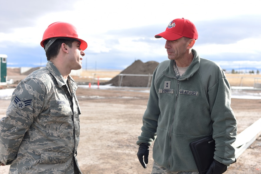U.S. Air Force Maj. Gen. Scott J. Zobrist, right, 9th Air Force commander, speaks with Senior Airman Jonathon Sikora at the 819th Rapid Engineer Deployable Heavy Operational Repair Squadron Engineers (RED HORSE) K-Span troop training site at Malmstrom Air Force Base, Mont., Jan. 25, 2018. The K-Span storage facility is under construction and will be used to store RED HORSE assets. RED HORSE Airmen capitalize on construction opportunities while at home to maintain proficiency for their overseas missions.