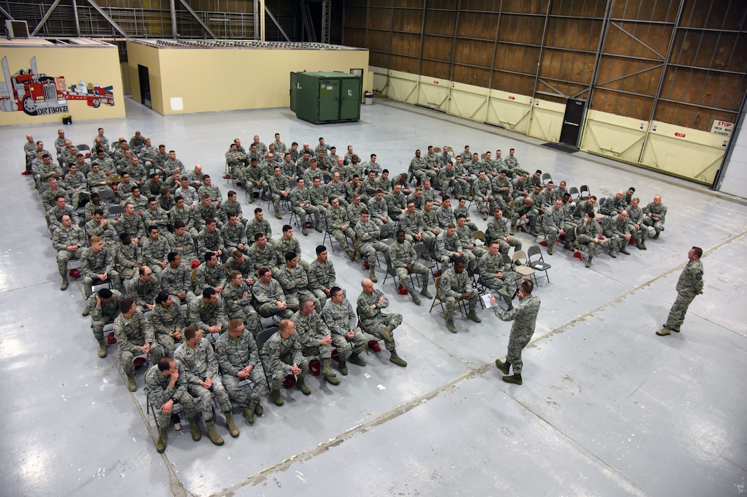 U.S. Air Force Maj. Gen. Scott J. Zobrist, 9th Air Force commander, and Chief Master Sgt. David Wade, 9th AF command chief, address Airmen of the 819th Rapid Engineer Deployable Heavy Operational Repair Squadron Engineers (RED HORSE) in a commander's call at Malmstrom Air Force Base, Mont., Jan. 25, 2018. During their visit, 9th AF leadership met with 819th RHS, base leaders and Airmen for a mission update and to thank the Airmen who are preparing for upcoming deployments this spring. (U.S. Air Force photo by Kiersten McCutchan)