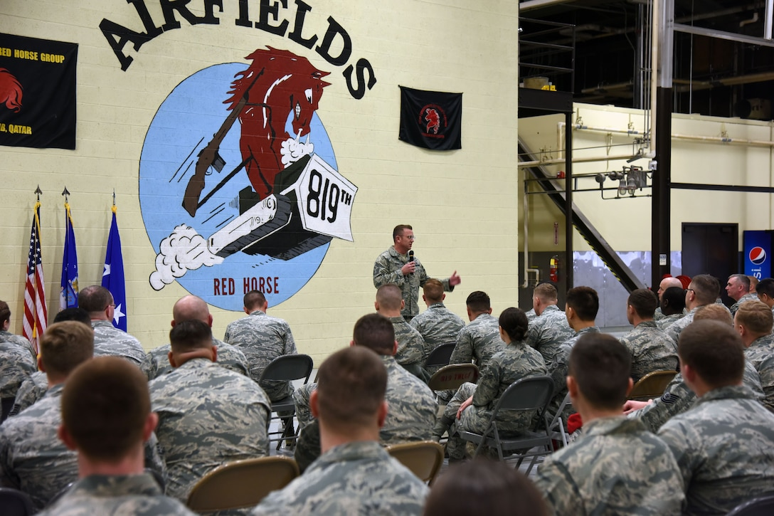 U.S. Air Force Chief Master Sgt. David W. Wade, 9th Air Force command chief, addresses members of the Rapid Engineer Deployable Heavy Operational Repair Squadron Engineers (RED HORSE) during a commander's call at Malmstrom Air Force Base, Mont., Jan. 25, 2018. During their visit, 9th AF leadership met with 819th RHS, base leaders and Airmen to thank them before they leave for upcoming deployments this spring. (U.S. Air Force photo by Kiersten McCutchan)