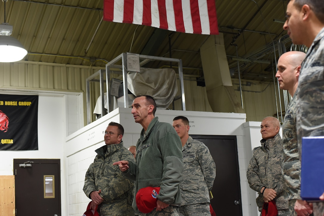 U.S. Air Force Maj. Gen. Scott J. Zobrist, center, 9th Air Force commander, and Chief Master Sgt. David W. Wade, 9th AF command chief, speak with Airmen from the 819th Rapid Engineer Deployable Heavy Operational Repair Squadron Engineers (RED HORSE) cantonments section, at Malmstrom Air Force Base, Mont., Jan. 25, 2018. During their trip, 9th AF leadership met with 819th RED HORSE Squadron, base leaders and Airmen for a mission update and to thank them for their support. (U.S. Air Force photo by Kiersten McCutchan)