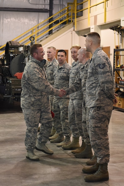 U.S. Air Force Chief Master Sgt. David W. Wade, 9th Air Force command chief, thanks members of the 819th Rapid Engineer Deployable Heavy Operational Repair Squadron Engineers (RED HORSE) power production section, at Malmstrom Air Force Base, Mont., Jan. 25, 2018. During his visit, Wade was briefed on the importance of the Mobile Aircraft Arresting System and the 819th RHS support to air shows around the country. (U.S. Air Force photo by Kiersten McCutchan)