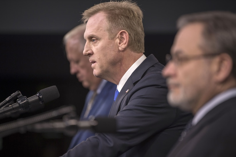Deputy Defense Secretary Patrick M. Shanahan and two government officials brief reporters at the Pentaon.