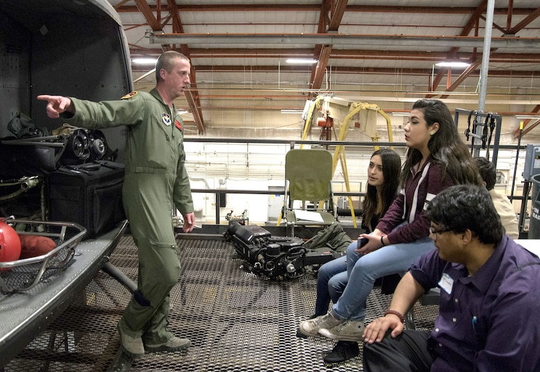 Staff Sgt. Eric Jensen, an instructor with the 58th Training Squadron, talks to students from Robert F. Kennedy Charter School in Albuquerque Feb. 1. The students visited several areas in the 58th Special Operations Wing as part of the Junior Achievement Job Shadow Program.