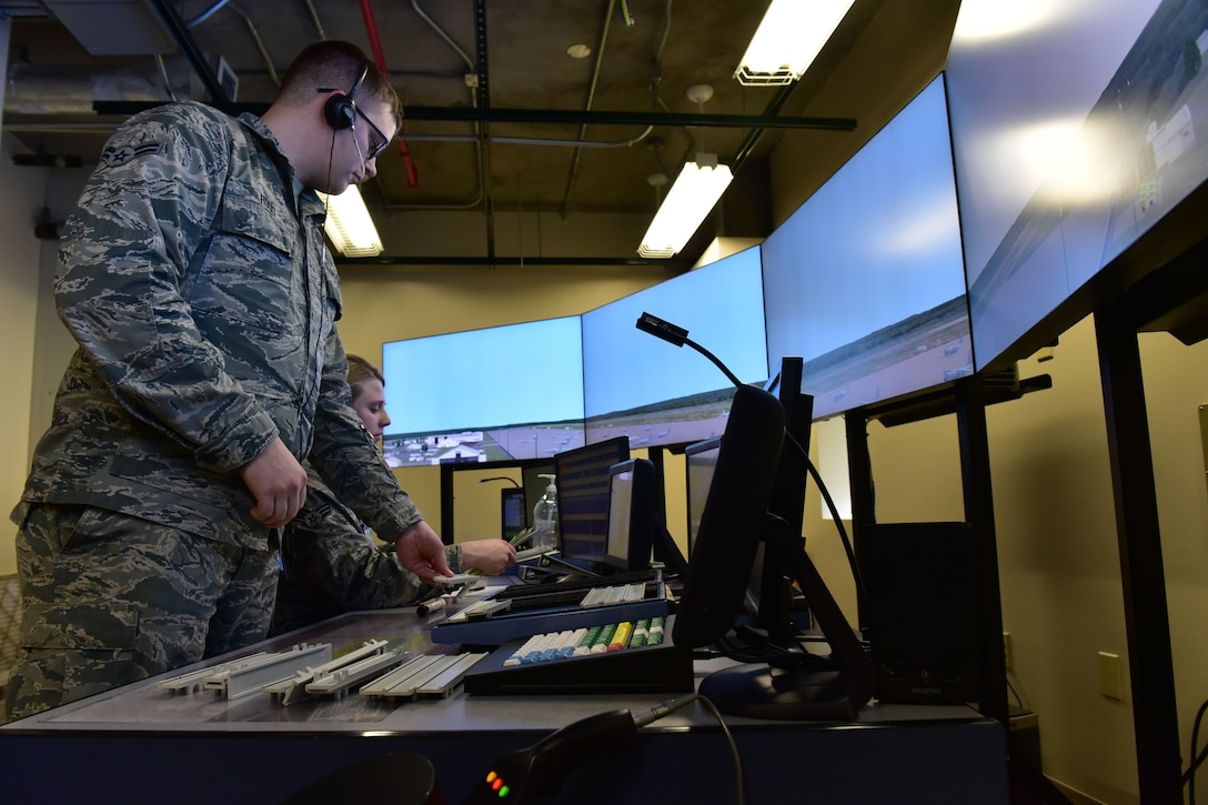 Airmen perform training using simulations in the air traffic control tower.