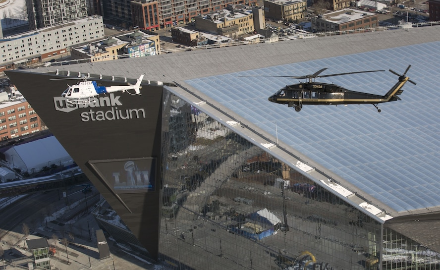 A U.S. Customs and Border Protection, Air and Marine Operations, AStar and a UH-60 Black Hawk helicopter fly over U.S. Bank Stadium in advance of Super Bowl LII in Minneapolis, Minn., Jan. 29, 2018. The Western Air Defense Sector worked with the CBP to enforce the Federal Aviation Administration's temporary 30-mile radius flight restricted area over the Super Bowl game. (U.S. Customs and Border Protection photo by Glenn Fawcett)