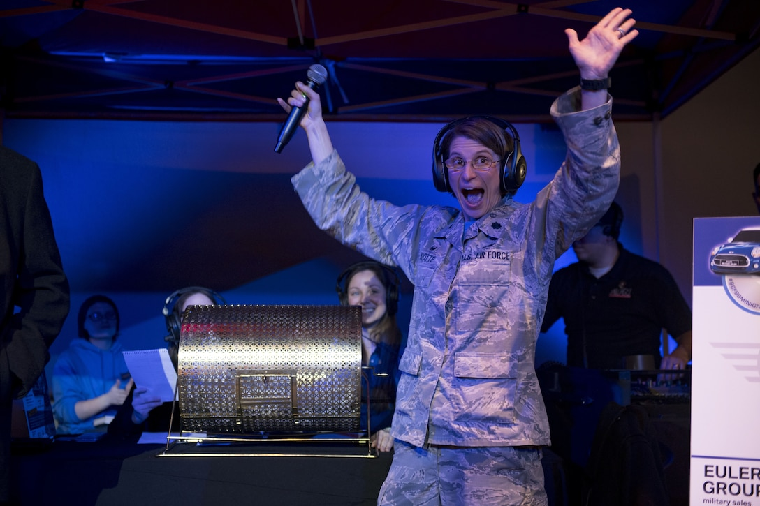 U.S. Air Force Lt. Col. Renee Thuotte, 86th Force Support Squadron commander, cheers during the Year of Giving Back Finale at the Enlisted Club on Ramstein Air Base, Germany, Feb. 2, 2018. The Year of Giving Back campaign consisted of 86 events spread out over the course of 2017 dedicated to giving back to the Kaiserslautern Military Community. (U.S. Air Force photo by Senior Airman Devin Boyer)