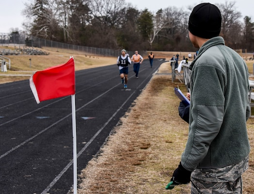 Airman 1st Class Nicholas, 22nd Intelligence Squadron fusion analyst working for ABLE Flight, conducts the run portion of an official Air Force Physical Training test, Jan. 29, 2018 at Fort George G. Meade, Md. ABLE Flight utilizes Airmen, who are waiting on their security clearances, to support prioritized Wing level jobs such as the Chaplain's office, Military Personnel Flight, Fitness Center, Inspector General's office, Dental Clinic, the Meade Attic, Transportation, Legal Office, Mailroom and many more. (U.S. Air Force photo/Staff Sgt. AJ Hyatt)