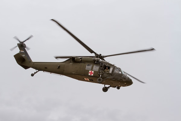 A medical evacuation UH-60 Black Hawk helicopter taking off after picking up a mock casualty from Florence Military Reservation.