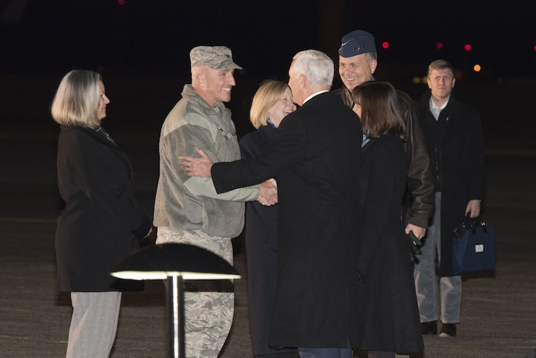 Col. Kenneth E. Moss, 374th Airlift Wing commander greets Vice President of the United States Michael R. Pence during his arrival at Yokota Air Base, Japan, Feb. 6, 2018.