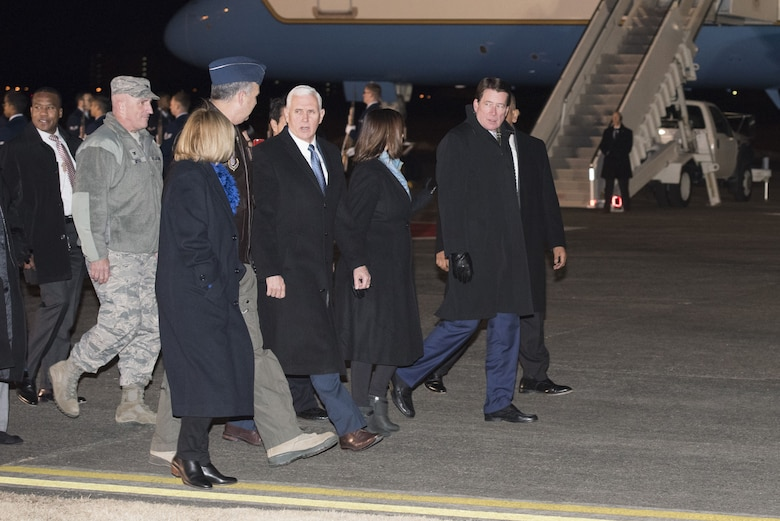 Vice President of the United States Michael R. Pence walks with Yokota leadership after his arrival to Yokota Air Base, Japan, Feb. 6, 2018.