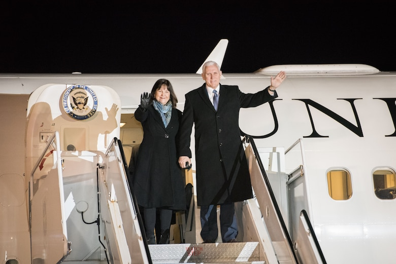 Vice President of the United States Michael R. Pence and wife Karen wave from Air Force II during his arrival at Yokota Air Base, Japan, Feb. 6, 2018.