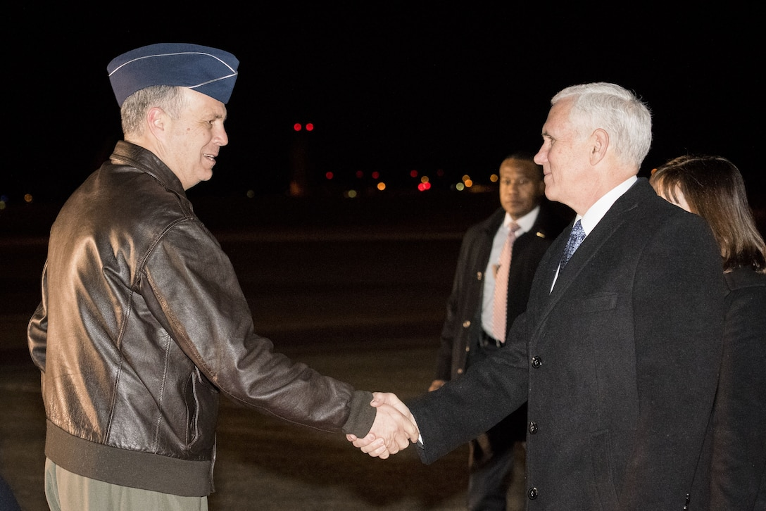 Lt. Gen. Jerry P. Martinez, Commander of United States Forces Japan greets Vice President of the United States Michael R. Pence during his arrival at Yokota Air Base, Japan, Feb. 6, 2018.