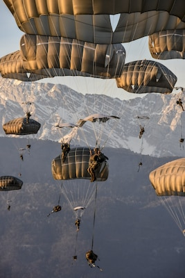 Hundreds of 173rd Airborne Brigade paratroopers conduct a tactical airborne insertion exercise onto Juliet Drop Zone in northern Italy, Jan. 24, 2018. Army photo by Lt. Col. John Hall