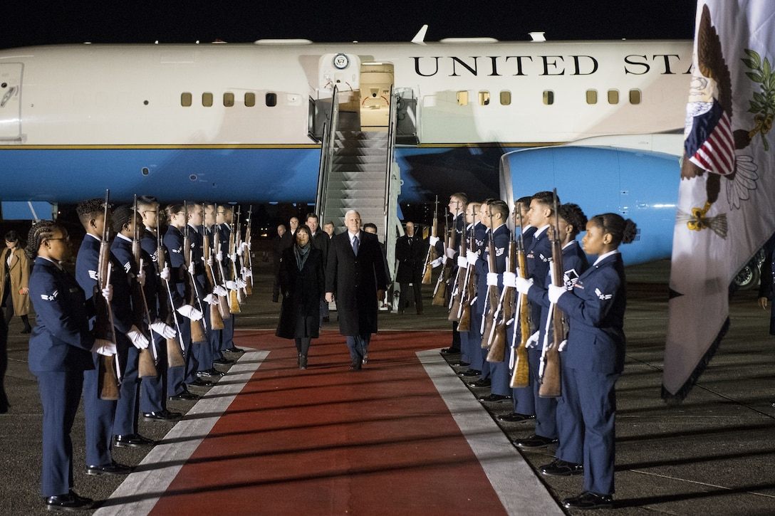 Vice President of the United States Michael R. Pence and wife Karen walk through a 374th Honor Guard cordon during his arrival at Yokota Air Base, Japan, Feb. 6, 2018.