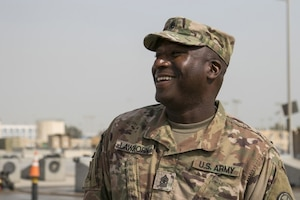 Sgt. Maj. Andre Lawhorn, 35th Infantry Division chemical, biological, radiological and nuclear sergeant major, enjoys a moment talking to his Soldiers during wash rack operations at Kuwait Naval Base.