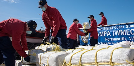 The crew of the Coast Guard Cutter Tampa offloads nearly two tons of cocaine Friday, Feb. 2, 2018