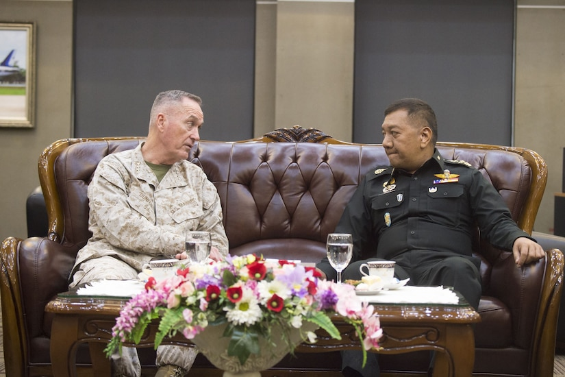 U.S and Thai defense leaders sit together and talk in Bangkok.