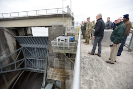 First responders take a look at the spillway gates at Old Hickory Dam on the Cumberland River during a tour during First Responders Day held at the project in Old Hickory, Tenn., Feb. 1, 2018. (USACE photo by Lee Roberts)