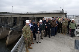 Participants of First Responders Day pose for a group photo on the lock wall of Old Hickory Dam during a tour of the project on the Cumberland River in Old Hickory, Tenn., Feb. 1, 2018. (USACE photo by Lee Roberts)