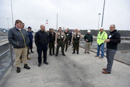 Joe Conatser (Right), U.S. Army Corps of Engineers Nashville District power plant manager at Old Hickory Dam, leads a tour of first responders on top of the dam during First Responders Day at the project on the Cumberland River in Old Hickory, Tenn., Feb. 1, 2018. (USACE photo by Lee Roberts)
