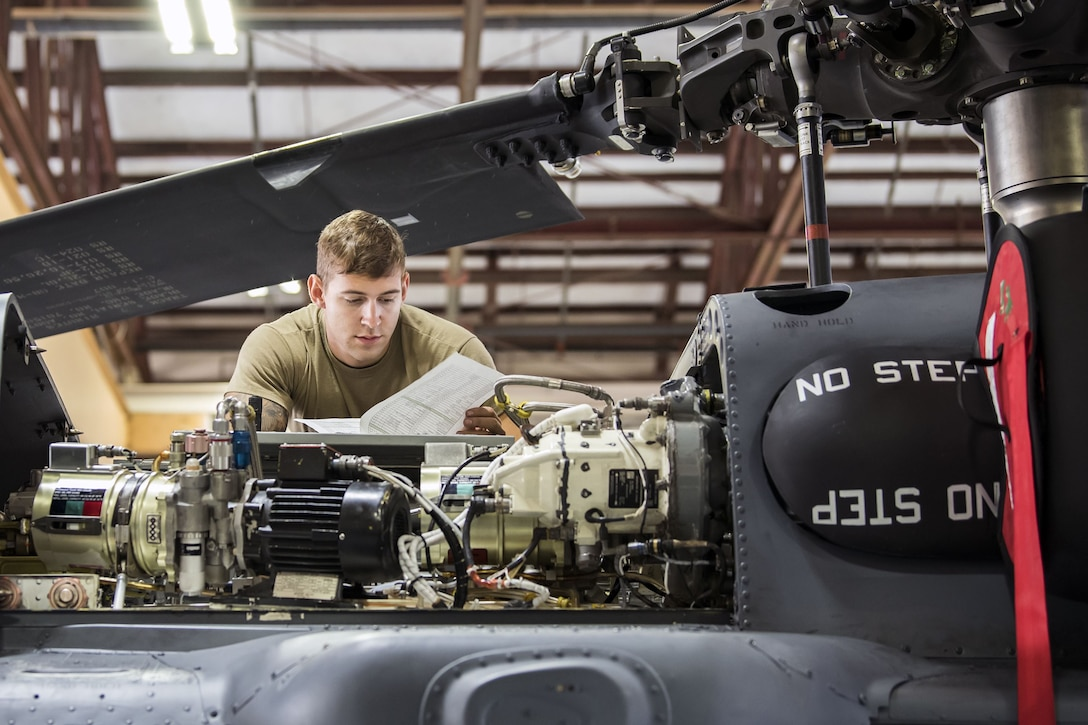 Senior Airman Joshua Herron, 723d Aircraft Maintenance Squadron (AMXS) HH-60G Pave Hawk crew chief, reads a technical order, Jan. 22, 2018, at Moody Air Force Base, Ga. From 16-25 Jan., Airmen from the 723d AMXS performed 216 hours of maintenance on an HH-60 after it returned to Moody following 350 days of depot maintenance at Naval Air Station (NAS) Jacksonville. While at NAS Jacksonville, the HH-60 underwent a complete structural overhaul where it received new internal and external components along with repairs and updated programming. (U.S. Air Force photo by Airman Eugene Oliver)