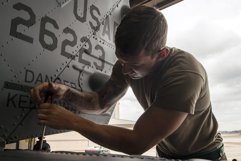 Senior Airman Joshua Herron, 723d Aircraft Maintenance Squadron (AMXS) HH-60G Pave Hawk crew chief, tightens a bolt, Jan. 22, 2018, at Moody Air Force Base, Ga. From 16-25 Jan., Airmen from the 723d AMXS performed 216 hours of maintenance on an HH-60 after it returned to Moody following 350 days of depot maintenance at Naval Air Station (NAS) Jacksonville. While at NAS Jacksonville, the HH-60 underwent a complete structural overhaul where it received new internal and external components along with repairs and updated programming. (U.S. Air Force photo by Airman Eugene Oliver)