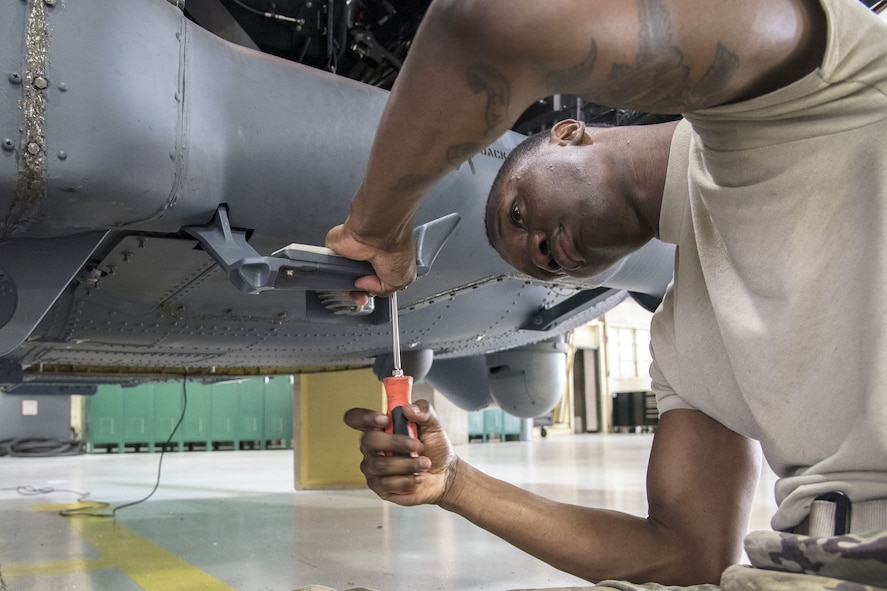 Airman 1st Class Marlon Natty, 723d Aircraft Maintenance Squadron (AMXS) HH-60G Pave Hawk crew chief, tightens a bolt, Jan. 22, 2018, at Moody Air Force Base, Ga. From 16-25 Jan., Airmen from the 723d AMXS performed 216 hours of maintenance on an HH-60 after it returned to Moody following 350 days of depot maintenance at Naval Air Station (NAS) Jacksonville. While at NAS Jacksonville, the HH-60 underwent a complete structural overhaul where it received new internal and external components along with repairs and updated programming. (U.S. Air Force photo by Airman Eugene Oliver)