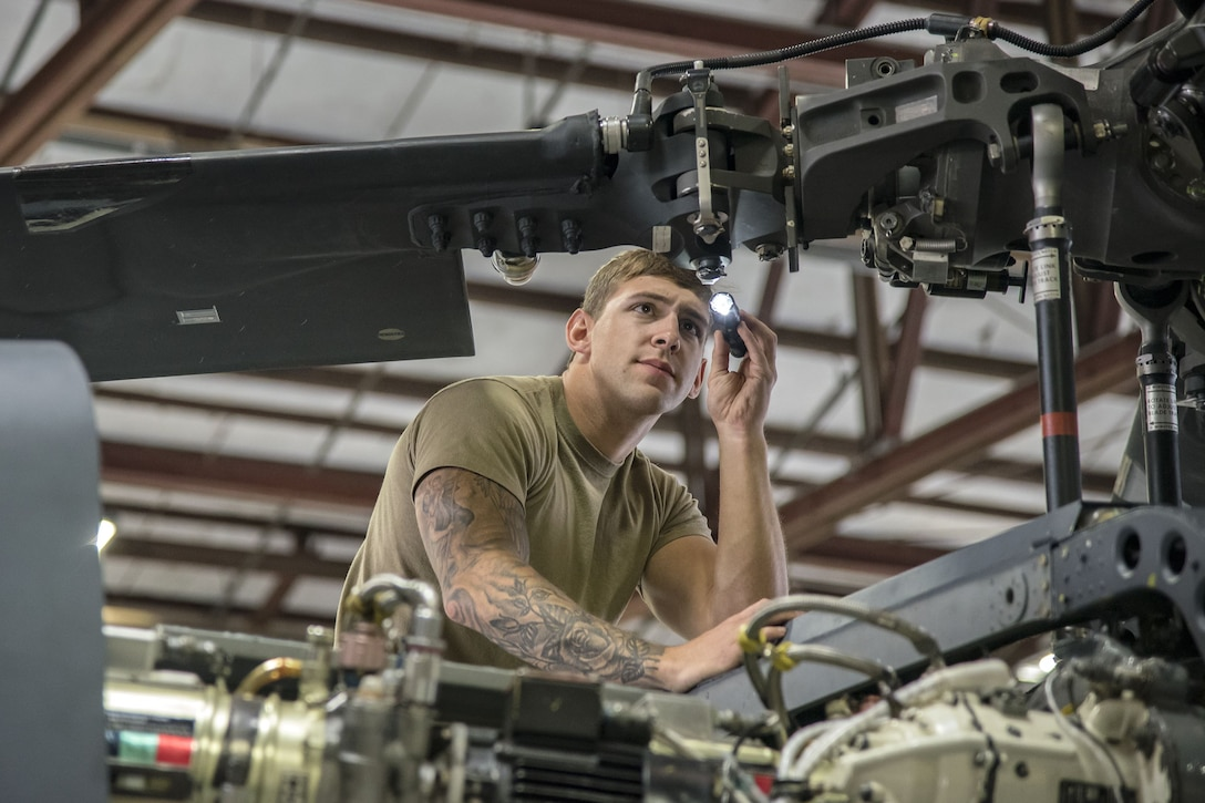 Senior Airman Joshua Herron, 723d Aircraft Maintenance Squadron (AMXS) HH-60G Pave Hawk crew chief, examines the propeller of an HH-60, Jan. 22, 2018, at Moody Air Force Base, Ga. From 16-25 Jan., Airmen from the 723d AMXS performed 216 hours of maintenance on an HH-60 after it returned to Moody following 350 days of depot maintenance at Naval Air Station (NAS) Jacksonville. While at NAS Jacksonville, the HH-60 underwent a complete structural overhaul where it received new internal and external components along with repairs and updated programming. (U.S. Air Force photo by Airman Eugene Oliver)