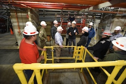 Joe Conatser (Holding Hands Up), U.S. Army Corps of Engineers Nashville District power plant manager at Old Hickory Dam, answers questions from a group of first responders in the hydropower plant during First Responders Day at the project on the Cumberland River in Old Hickory, Tenn., Feb. 1, 2018. (USACE photo by Lee Roberts)