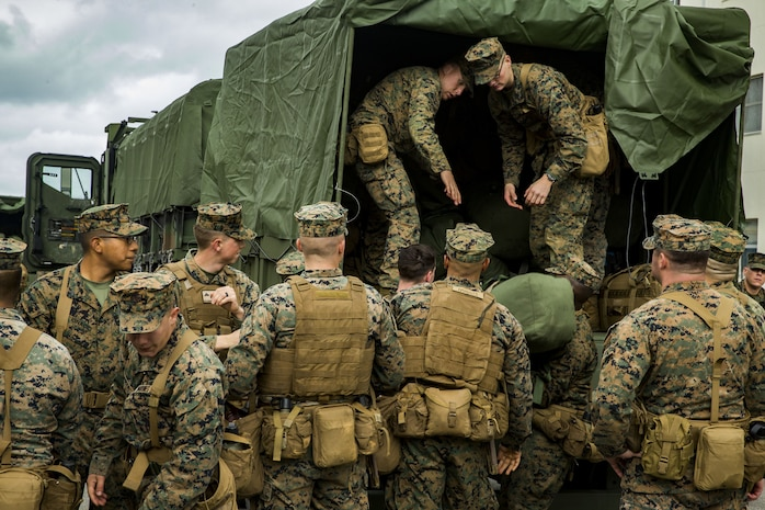 U.S. Marines with Headquarters and Service Company, 3rd Battalion, 3rd Marine Regiment, 3rd Marine Division, form a conveyer belt to load sea bags into the back of a 7ton truck in Okinawa, Japan, Feb. 1, 2018. The Marines are preparing to embark on the amphibious assault ship USS Bonhomme Richard (LHD-6) going to Thailand to participate in Exercise Cobra Gold 2018. Cobra Gold 18 is an annual exercise conducted in the Kingdom of Thailand and runs from Feb. 13-23 with seven full participating nations.