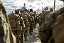 U.S. Marines with Headquarters and Service Company, 3rd Battalion, 3rd Marine Regiment, 3rd Marine Division, march on the pier towards the amphibious assault ship USS Bonhomme Richard (LHD-6) in Okinawa, Japan, Feb. 1, 2018. The Marines are preparing to embark on the USS Bonhomme Richard going to Thailand to participate in Exercise Cobra Gold 2018. Cobra Gold 18 is an annual exercise conducted in the Kingdom of Thailand and runs from Feb. 13-23 with seven full participating nations.