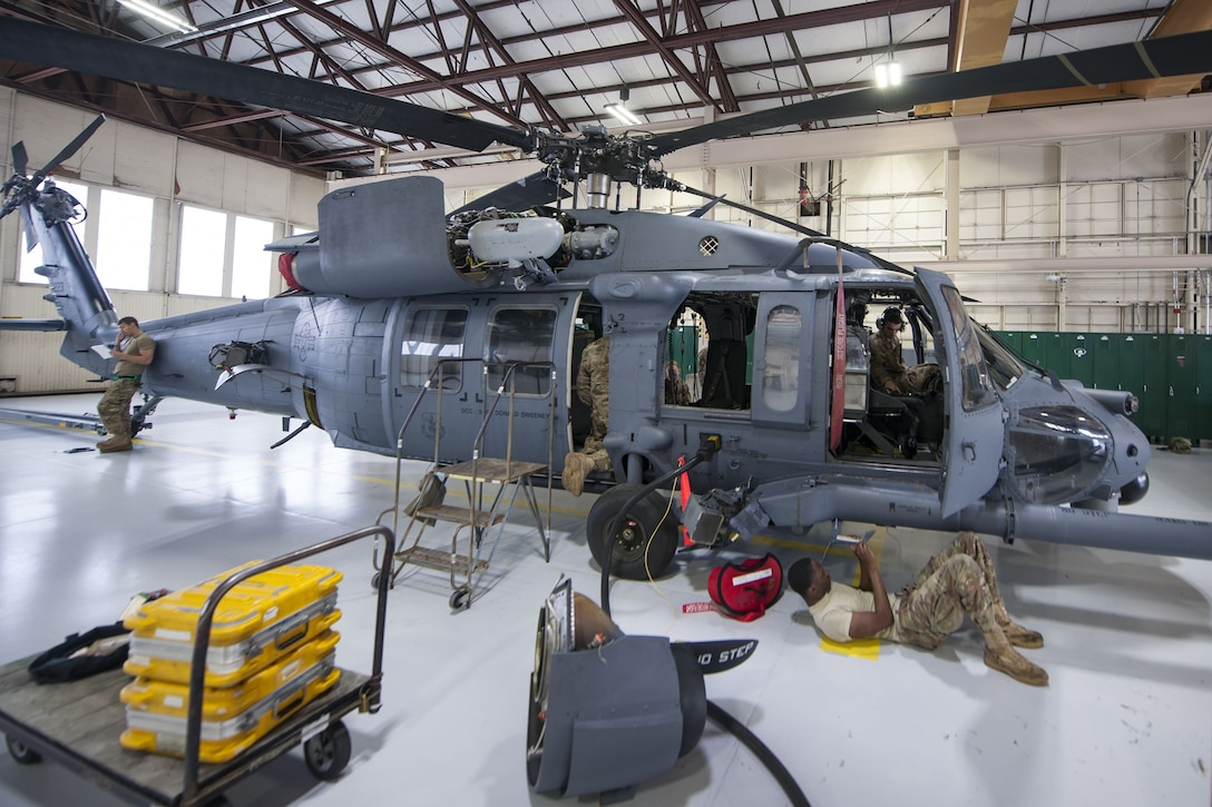 Airmen from the 723d Aircraft Maintenance Squadron (AMXS) perform maintenance on an HH-60G Pave hawk, Jan. 22, 2018, at Moody Air Force Base, Ga. From 16-25 Jan., Airmen from the 723d AMXS performed 216 hours of maintenance on an HH-60 after it returned to Moody following 350 days of depot maintenance at Naval Air Station (NAS) Jacksonville. While at NAS Jacksonville, the HH-60 underwent a complete structural overhaul where it received new internal and external components along with repairs and updated programming. (U.S. Air Force photo by Airman Eugene Oliver)