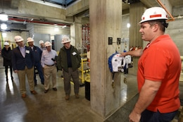 Mike Corcoran (Red Shirt), mechanic at the Old Hickory Dam Hydropower Plant, leads participants of First Responders Day during a tour of the project on the Cumberland River in Hendersonville, Tenn., Feb. 1, 2018. (USACE photo by Leon Roberts)