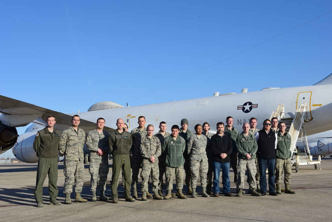 Members of the 595th Command and Control Group stand in front of an E-6B following a tour of the aircraft during the 625th Strategic Operations Squadron's Deep Dive held at Offutt Air Force Base, Neb., Jan. 25, 2018. The Deep Dive is part of an effort by the group to give members of different squadrons insight into squadron-specific missions and an understanding of how their missions work together.