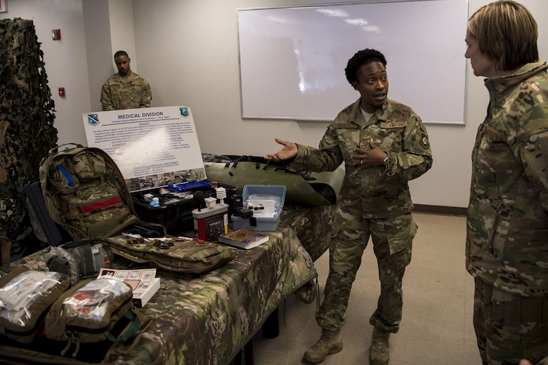 Tech. Sgt. Leticia Brazil, 823d Base Defense Squadron independent duty medical technician, displays her equipment and describes her mission to Col. Jennifer Short, 23d Wing commander, during a capabilities demonstration, Feb. 5, 2018, at Moody Air Force Base, Ga. The immersion was designed to give the 23d Wing's leadership a better understanding of the 820th Base Defense Group's mission, capabilities and training needs. (U.S. Air Force photo by Senior Airman Daniel Snider)