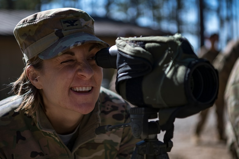 Col. Jennifer Short, 23d Wing commander, attempts to spot a hidden member of the 820th Base Defense Group's Close Precision Engagement Team during a capabilities demonstration, Feb. 5, 2018, at Moody Air Force Base, Ga. The immersion was designed to give the 23d Wing's leadership a better understanding of the 820th BDG's mission, capabilities and training needs. (U.S. Air Force photo by Senior Airman Daniel Snider)