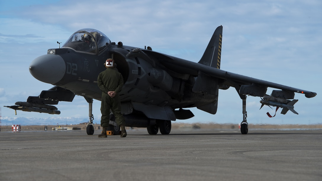 Corporal Tyler Fry, Marine Attack Squadron 542 powerline plane captain, walks around an AV-8B Harrier II during a pre-flight inspection Jan. 31, 2018, at Mountain Home Air Force Base, Idaho. Working in cold weather conditions and side-by-side with the Air Force will help VMA-542 train for its mission. (U.S. Air Force Photo by Airman 1st Class JaNae Capuno)