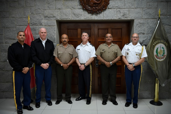 U.S. Army Maj. Edward Figueroa (far left), Army South section chief, Command Sgt. Maj. James L. Allen, West Virginia National Guard senior enlisted leader, Lt. Gen. Oscar Reto Otero, Peruvian army chief of staff, Gen. Cesar Astudillo, Commanding General of the Peruvian army and Col. Edward Ortiz, Army Defense Attache for the U.S. Embassy in Peru, pose for a photo at the Peruvian Army Headquarters.
