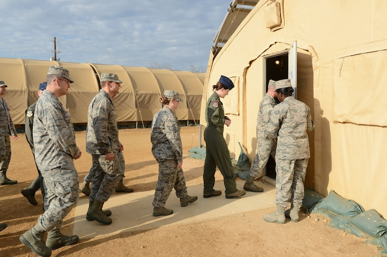 Members of the 62nd Airlift Wing command staff walk into a tent January 11, 2018, at the Basic Expeditionary Airman Skills Training site on the Medina Annex of Joint Base San Antonio, Texas